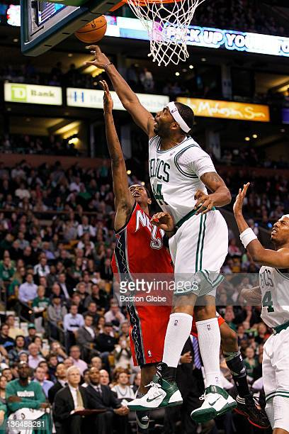 Celtics forward/center Chris Wilcox blocks a shot attempt by the Nets' MarShon Brooks in the 3rd quarter The Boston Celtics play the New Jersey Nets...