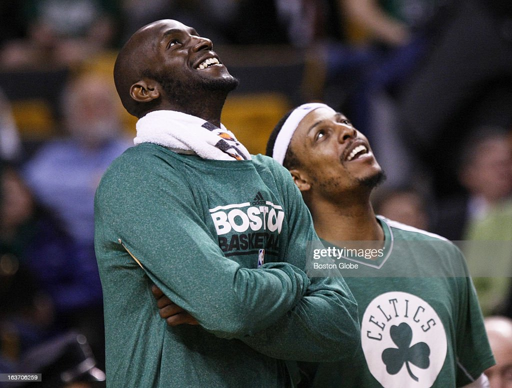Celtics forwards Kevin Garnett (#5) and Paul Pierce (#34) watch 'Gino Time' on the jumbotron and were able to get some rest due to a blowout win. The Boston Celtics hosted the Toronto Raptors at the TD Garden during a regular season NBA game in Boston, Mass. on Wednesday, March 13, 2013.