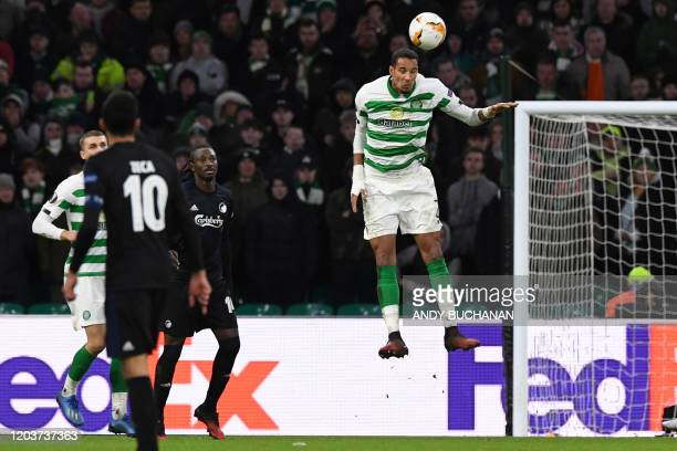 Celtic's French defender Christopher Jullien heads the ball clear during the UEFA Europa League round of 32 second leg football match between Celtic...