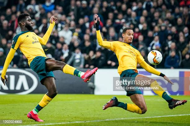 Celtic's French defender Christopher Jullien plays the ball as Celtic's French forward Odsonne Edouard looks on during the Europa League last 32...