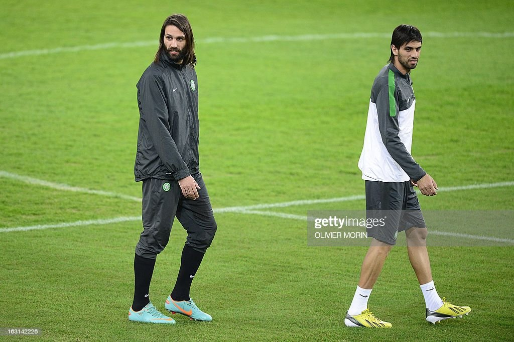 Celtic's French forward Lassad Nouioui (R) and Celtic's Greek forward Giorgios Samaras enter the pitch during a training session on the eve of the Champions League match between Juventus and Celtic Glasgow on March 5, 2013 in Turin.