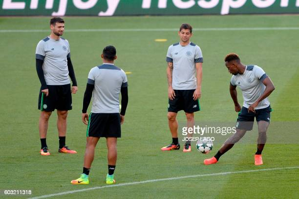 Celtic's French forward Moussa Dembele Celtic's Costarican defender Cristian Gamboa and Turkish forward Nadir Ciftci attend a training session at the...