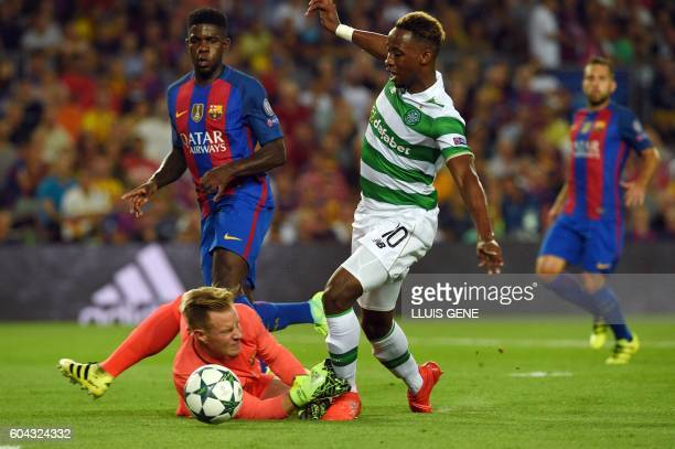 Celtic's French forward Moussa Dembele vies with Barcelona's German goalkeeper MarcAndre Ter Stegen during their Champions League football match...