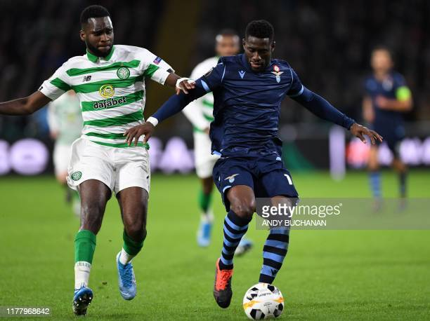 Celtic's French forward Odsonne Edouard vies with Lazio's Angolan defender Bastos during the UEFA Europa League group E football match between Celtic...