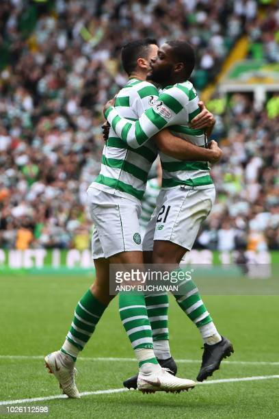 Celtic's French midfielder Olivier Ntcham celebrates with Celtic's Australian midfielder Tom Rogic after scoring the team's first goal during the...