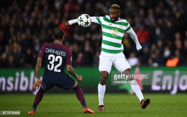 Celtic's French striker Moussa Dembele fights for the ball with Paris SaintGermain's Brazilian defender Dani Alves during the UEFA Champions League...