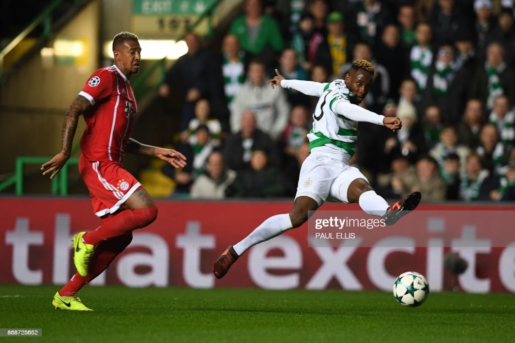 Celtic's French striker Moussa Dembele (R) has a shot on goal by Bayern Munich's Austrian defender David Alaba during the UEFA Champions League Group B football match between Celtic and Bayern Munich at Celtic Park in Glasgow, on October 31, 2017. / AFP PHOTO / Paul ELLIS