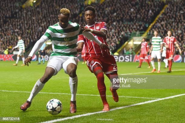 Celtic's French striker Moussa Dembele vies with Bayern Munich's Austrian defender David Alaba during the UEFA Champions League Group B football...