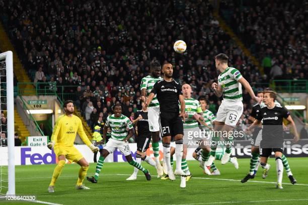 Celtic's French striker Odsonne Edouard jumps for the ball against Rosenborg's Tunisian striker Issam Jebali during the UEFA Europa League group B...