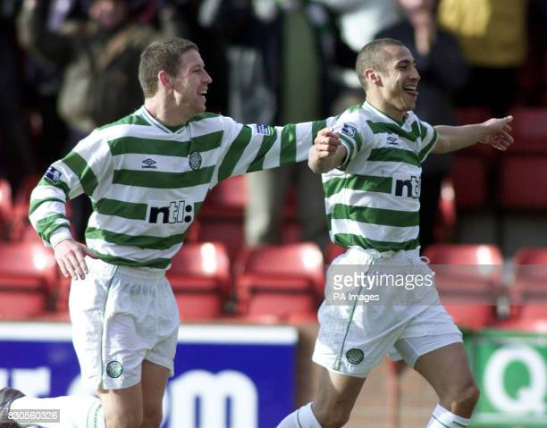Celtic's Henrik Larsson celebrates his goal against Dunfermline with team mate Alan Thompson during their Scottish Premier League football match at...