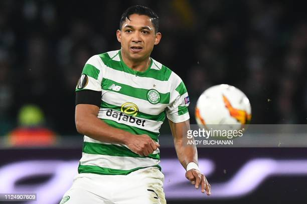 Celtic's Honduran defender Emilio Izaguirre plays the ball during the UEFA Europa League round of 32 first leg football match between Celtic and...