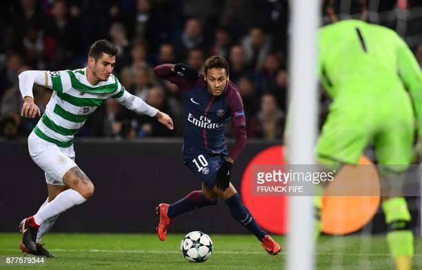 Celtic's Israeli midfielder Nir Bitton fights for the ball with Paris SaintGermain's Brazilian striker Neymar during the UEFA Champions League Group...