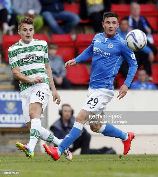 Celtic's James Forrest and St Johnstone's Michael O'Halloran battle for the ball during the Scottish Premier League match at McDiarmid Park Perth