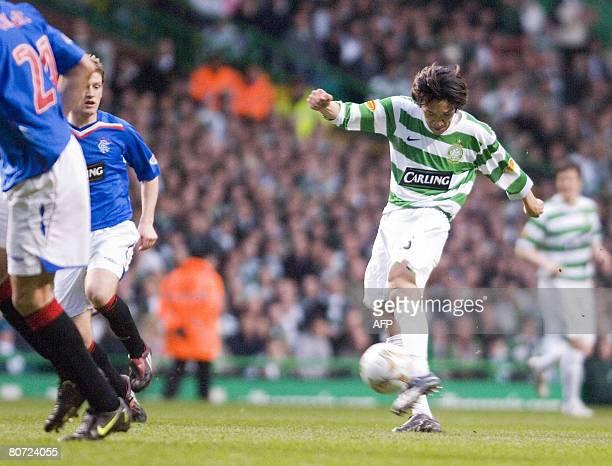 Celtic's Japanese footballer Shensuke Nakamura scores the opening goal against Rangers at Celtic Park in Scotland, on April 16, 2008. AFP PHOTO/BRIAN...