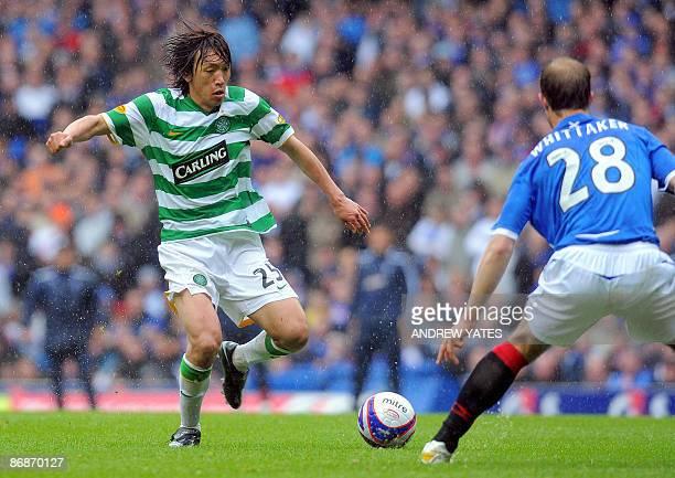 Celtic's Japanese midfielder Shunsuke Nakamura vies with Rangers' Scottish defender David Weir and midfielder Steven Whittaker during the Scottish...