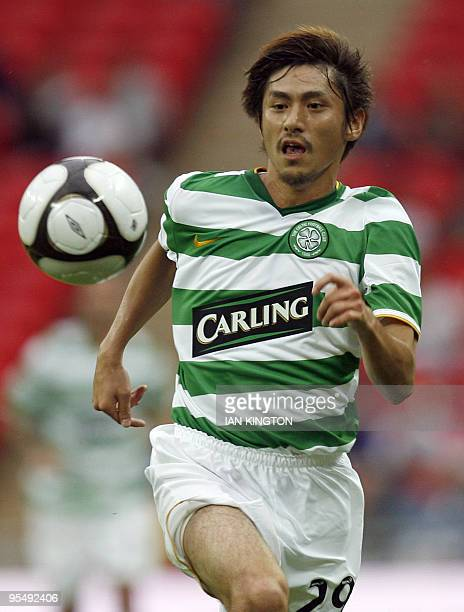 Celtic's Japanese player Koki Mizuno during the match against Tottenham Hotspurs French footballer Pascal Chimbonda during the Wembley Cup...