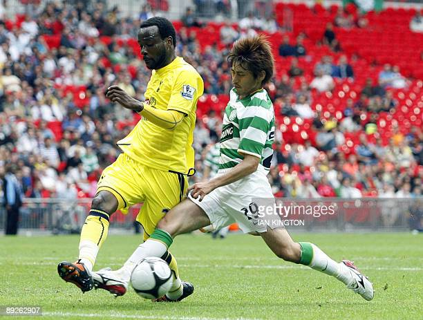 Celtic's Japanese player Koki Mizuno shot is blocked by Tottenham Hotspurs French footballer Pascal Chimbonda during the Wembley Cup competition at...