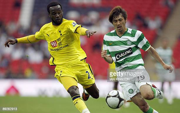 Celtic's Japanese player Koki Mizuno vies with Tottenham Hotspurs French footballer Pascal Chimbonda during the Wembley Cup competition at Wembley...