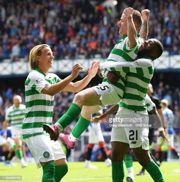 Celtic's Jonny Hayes celebrates his goal with teammates during the Ladbrokes Premier match between Rangers and Celtic at Ibrox Stadium, on September...