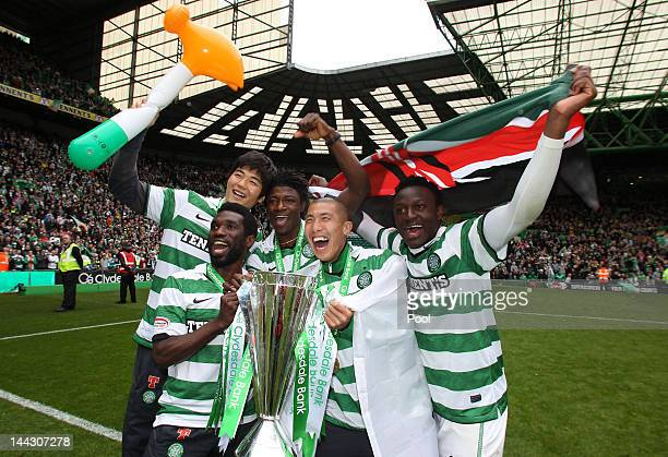 Celtic's Ki Sung Yeung Andre Blackman Victor Wanyama Rabiu Ibrahim and Cha DuRi celebrate with the league trophy following the Clydesdale Bank...