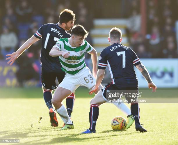 Celtic's Kieran Tierney beats Ross County players Ross Draper and Michael Garden during the Ladbrokes Scottish Premiership match at the Global Energy...