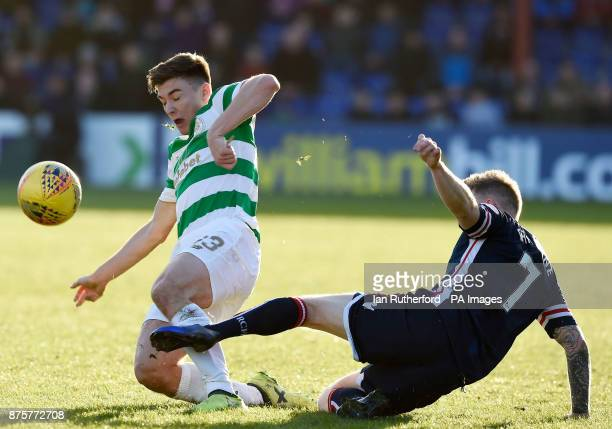Celtic's Kieran Tierney tackles Ross County's Michael Garden resulting in a yellow card during the Ladbrokes Scottish Premiership match at the Global...