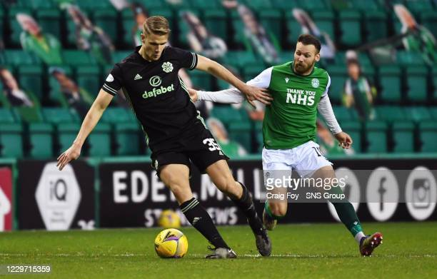 Celtic's Kris Ajer and Martin Boyle in action during a Scottish Premiership match between Hibernian and Celtic at Easter Road on November 21 in...