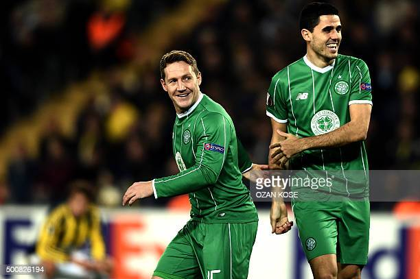 Celtic's Kris Commons celebrates with his teammate Tom Rogic after scoring during the UEFA Europa League football match between Fenerbahce and Celtic...