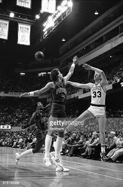 Celtics' Larry Bird passes off as he is guarded closely by Pistons' Kelly Tripucka and Isiah Thomas during 2nd quarter action at Boston Garden 4/10...