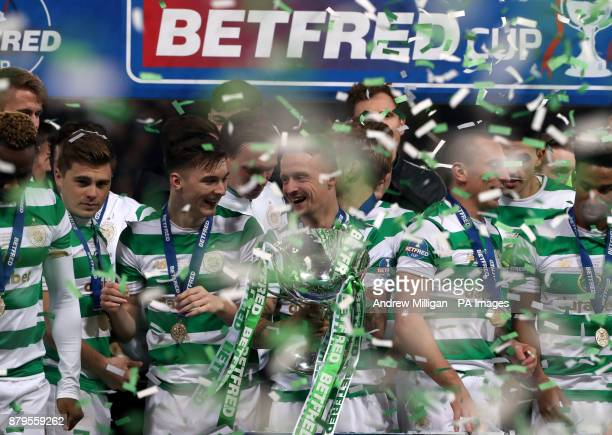 Celtic's Leigh Griffiths celebrates with the trophy after winning the Betfred Cup Final at Hampden Park Glasgow