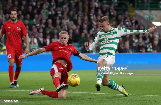 Celtic's Leigh Griffiths challenges Suduva Algis Jankauskas during the UEFA Europa League PlayOff Second Leg match at Celtic Park Glasgow