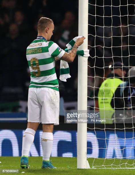 Celtic's Leigh Griffiths ties a Celtic scarf to the goal post after winning the Betfred Cup Final at Hampden Park Glasgow