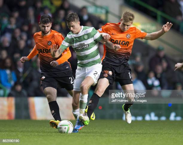 Celtic's Mikael Lustig is squeezed out by Dundee United's Nadir Ciftci and Stuart Armstrong during the Scottish Premiership match at Celtic Park...
