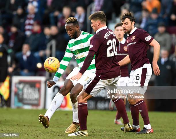 Celtics Moussa Dembele tries to get past Hearts Ross Callachan and Connor Randall during the Ladbrokes Scottish Premiership match at Tynecastle...