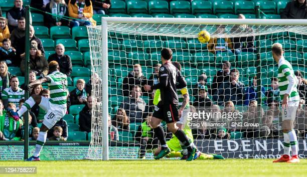 Celtic's Moussa Dembele watches in horror as his sliced clearance crashes off the crossbar