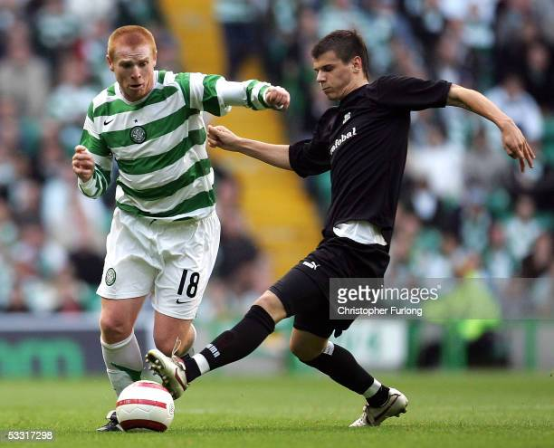 Celtic's Neil Lennon evades a tackle from Jan Durica of Artmedia Bratislava during the UEFA Champions League first qualifying round second leg match...