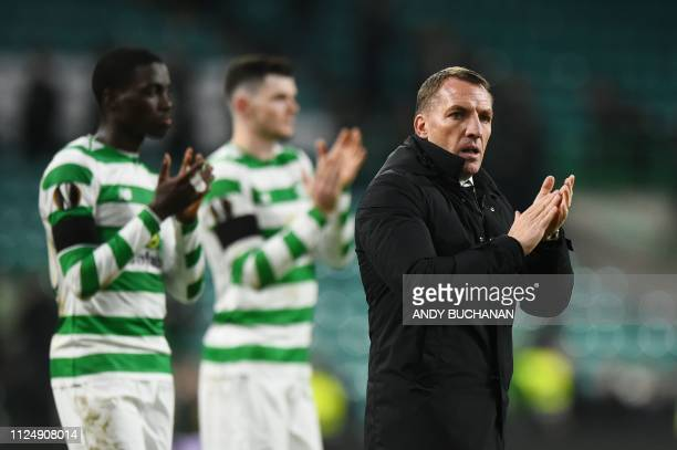 Celtic's Northern Irish manager Brendan Rodgers applauds at the end of the UEFA Europa League round of 32 first leg football match between Celtic and...