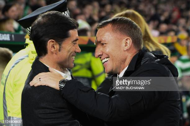 Celtic's Northern Irish manager Brendan Rodgers greets Valencia's Spanish coach Marcelino Garcia Toral during the UEFA Europa League round of 32...