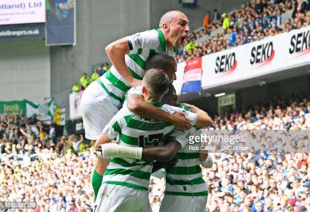 Celtic's Odsonne Edouard celebrates his opener with teammates during the Ladbrokes Premier match between Rangers and Celtic at Ibrox Stadium, on...