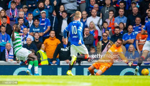 Celtic's Odsonne Edouard scores the opener during the Ladbrokes Premier match between Rangers and Celtic at Ibrox Stadium, on September 1 in Glasgow,...