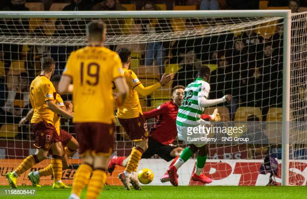 Celtic's Odsonne Edouard slots past Motherwells Mark Gillespie to make it 10 during a Ladbrokes Premiership match between Motherwell and Celtic at...
