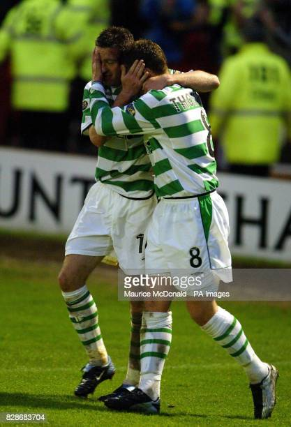 Celtic's Paul Lambert with team mate Alan Thompson after the fourth goal against Motherwell in the Scottish Premiere League match at Fir Park...