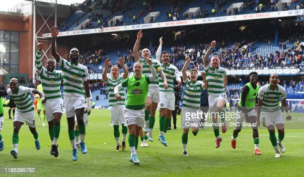 Celtic's players celebrate at full time during the Ladbrokes Premier match between Rangers and Celtic at Ibrox Stadium, on September 1 in Glasgow,...