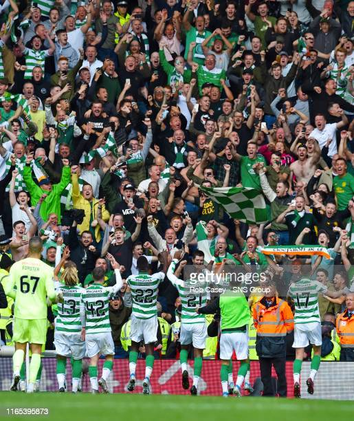 Celtic's players celebrate in front of their fans at full time during the Ladbrokes Premier match between Rangers and Celtic at Ibrox Stadium, on...