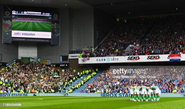 Celtic's players form a huddle during the Ladbrokes Premier match between Rangers and Celtic at Ibrox Stadium, on September 1 in Glasgow, Scotland.