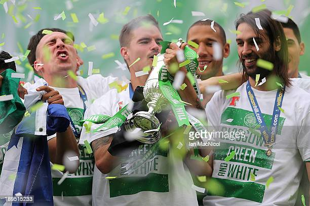 Celtic's players Scott Brown Mikael Lustig Kelvin Wilson and Georgios Samaras lifts the trophy after defeating Hibernian 30 during the William Hill...