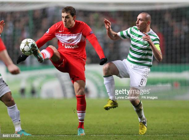 Celtic's Scott Brown and Moscow's Artem Dzuba during the UEFA Champions League match at Celtic Park Glasgow