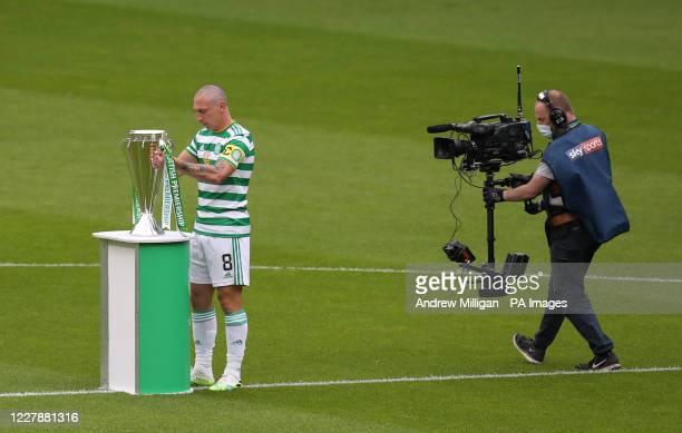 Celtic's Scott Brown Carrie the Scottish Premiership trophy on pitch during the Scottish Premiership match at Celtic Park, Glasgow.