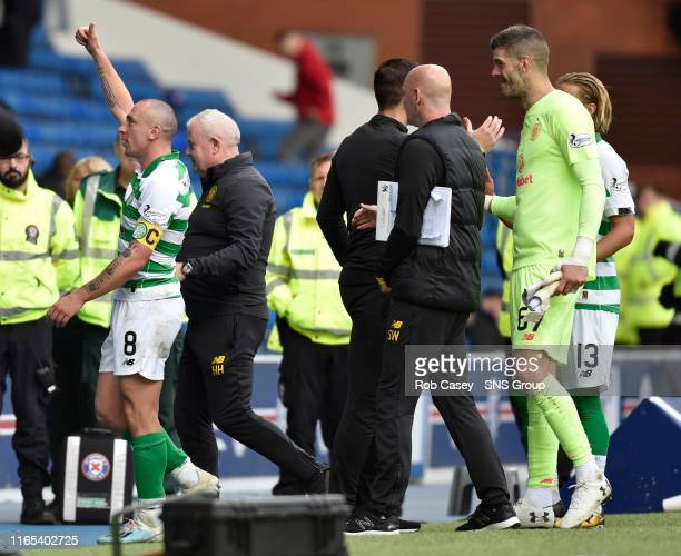 Celtic's Scott Brown gestures to fans during the Ladbrokes Premier match between Rangers and Celtic at Ibrox Stadium, on September 1 in Glasgow,...