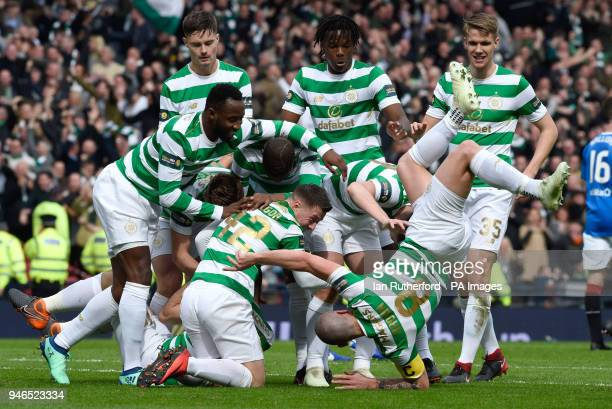 Celtic's Scott Brown takes a tumble as they celebrate after Tomas Rogic scores his side's first goal of the game during the William Hill Scottish Cup...